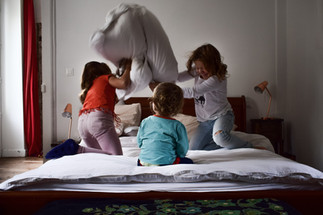 Playing on bed family portraiture.jpg