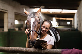 smiling-female-jockey-using-digital-tabl