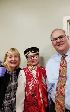 Executive Director Patricia Flaherty, MHNHS President Maria Sanchez, and NEBH President David Passafaro serving turkey at an MHNHS event