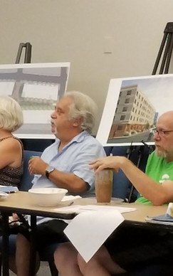 Board members Cindy Walling, Mitch Hilton, Bruce Keary, and Rich Giordano at a meeting concerning Parcel 25