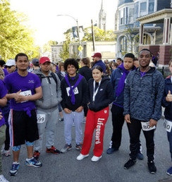 Group photo of Sociedin the annual Mission Hill Road Race