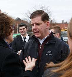 Former mayor Martin Walsh speaking with former board member Susan St. Clair