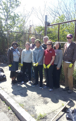 "Volunteers with ""Boston Shines"" patrcipating in a clean up of the Roxbury Crossing MBTA Area"
