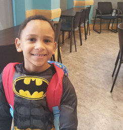 A young resident with dreams of fighting crime enjoys himself at a back-to-school event sponsored by NEBH and MHNHS