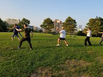 Parkgoers enjoy an outdoor Tai Chi class