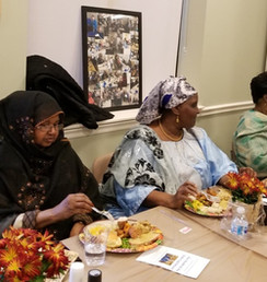 Residents enjoy food at an event sponsored by MHNHS