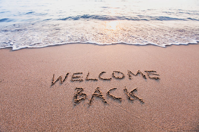 welcome back, text on sand beach, touris
