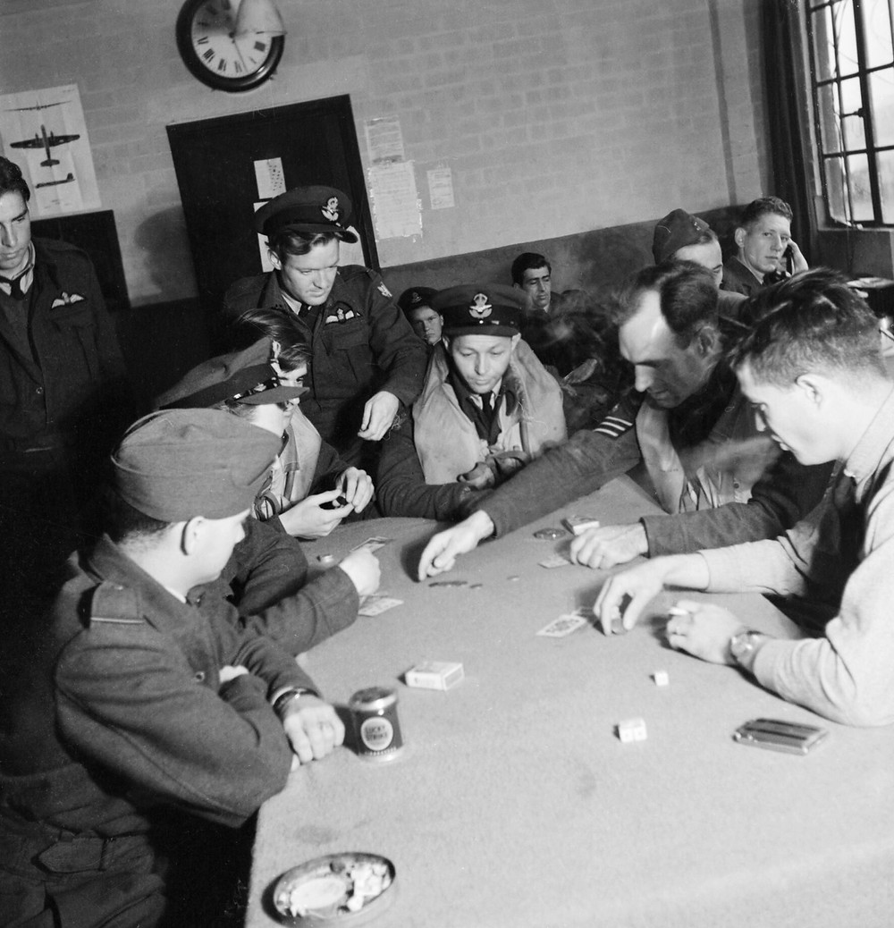 (Eagle) Squadron play Poker as they await the order to 'scramble'.