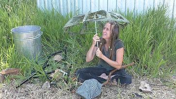Australian actress and singer Ohroara with a broken umbrella