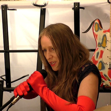 Ohroara with red gloves in the studio