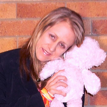 Ohroara Christian pop singer hugs a teddy bear