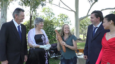 Australia producer Ohroara is given a baguette by actress Wendy