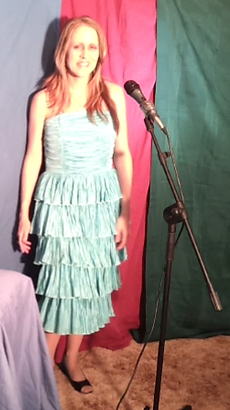 pretty lady in blue dress with microphone