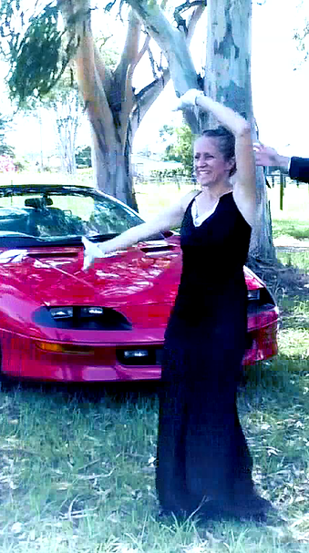 Ohroara in Sun Or Rain music video, a Christian song by Australian music and video producer with red camaro sports car
