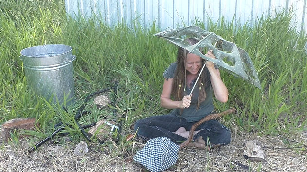 Australian Christian singer Ohroara with a broken umbrella