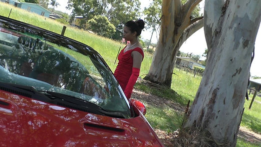 Actress Suniti with a red camaro during filming in Australia
