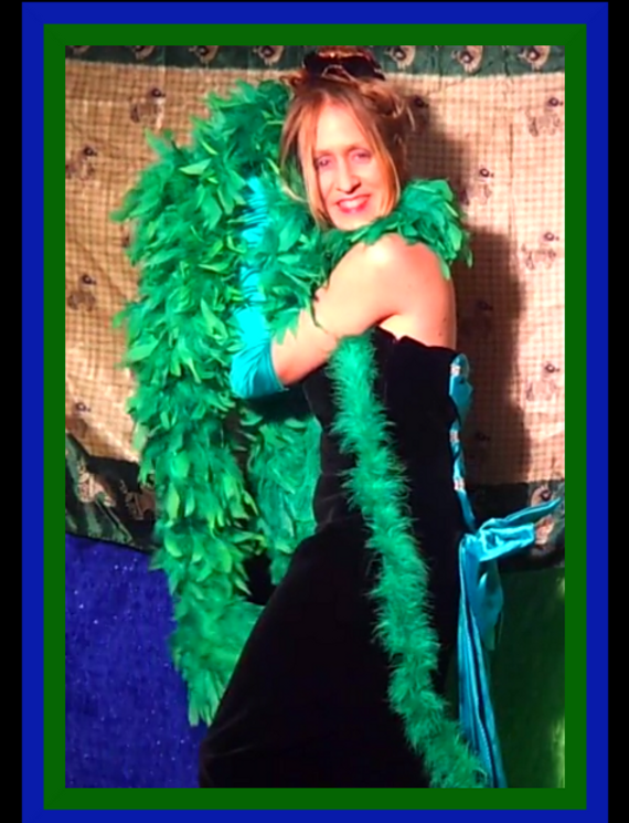 Christian lady singer photoshoot pretty feather boa green black dress