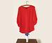 chemise rouge sur cintre