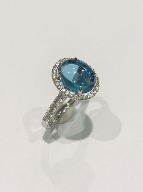 Blue Topaz and Diamond Cluster ring.