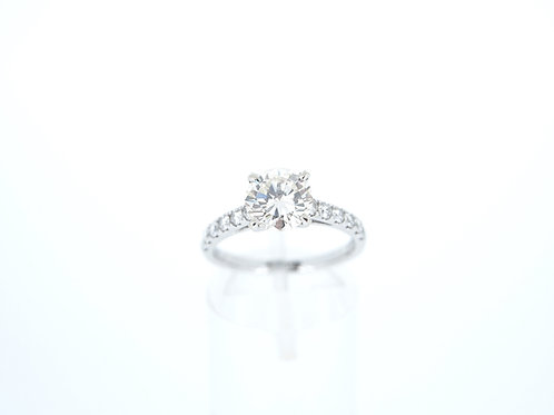 18ct white gold round brilliant cut diamond single stone ring.