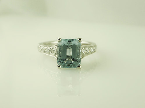 Aquamarine with diamond shoulders ring