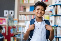 smiling-hispanic-boy-at-school-PDQS85C