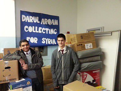 Our students from the Ummah in Focus Club, during our coat drive for Syria