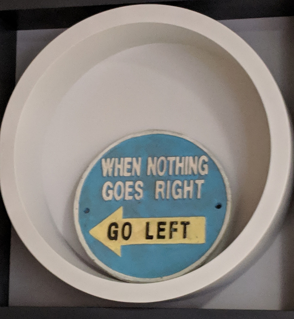"""Photo of a plaque that says """"When nothing goes right, go left"""""""