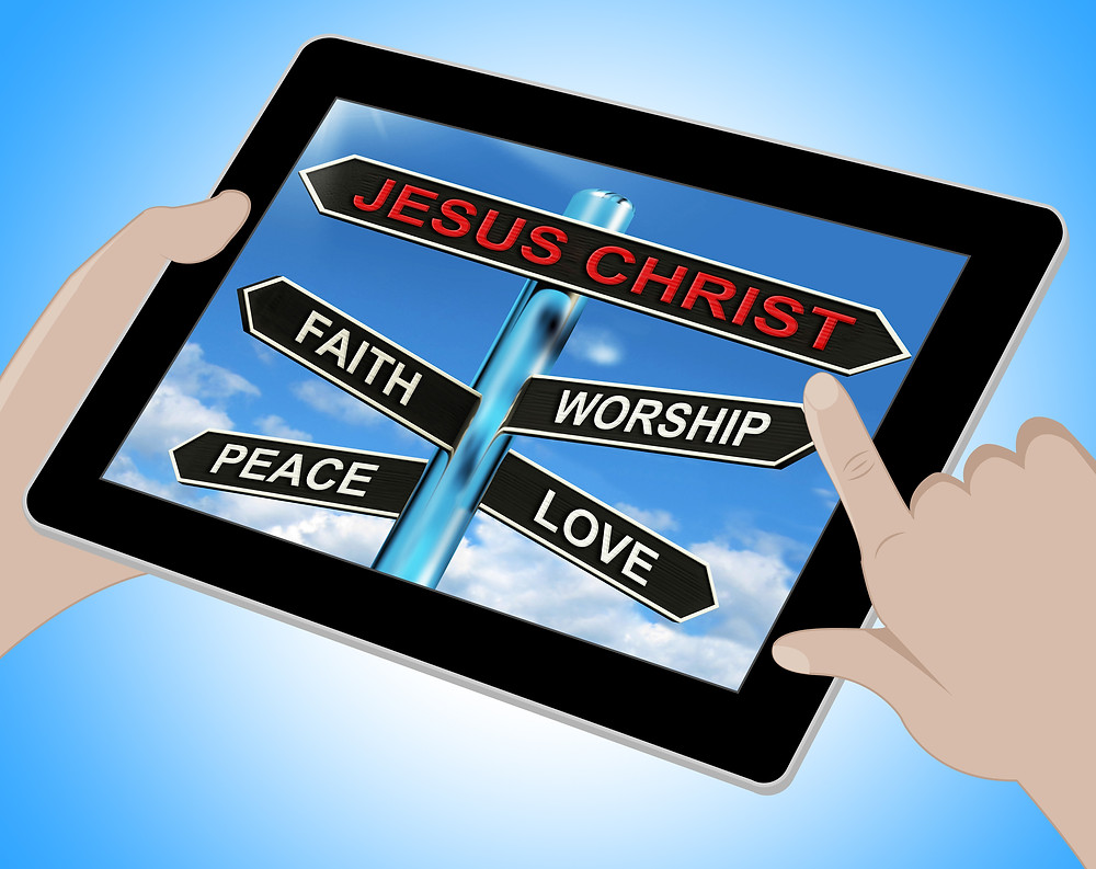 Picture of a tablet device with a picture of a signpost pointing in different directions to Jesus, Faith, Worship, Peace and love