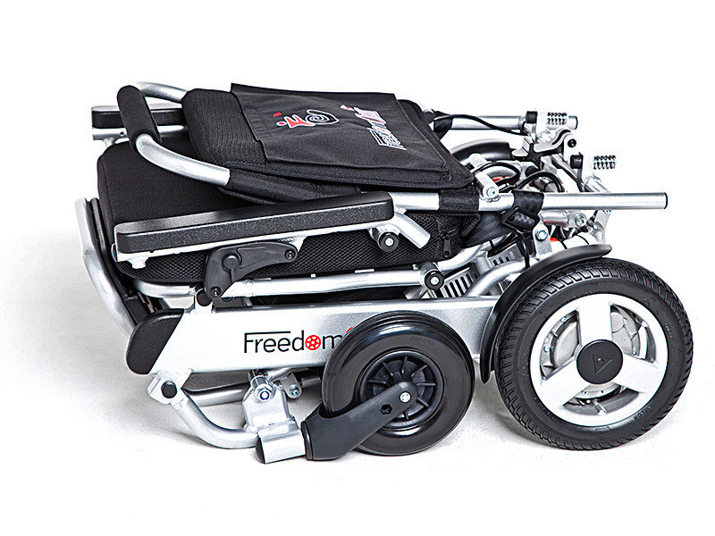 A picture of a power wheel chair (Called a freedom chair) folded down, ready to go into the boot of a car.