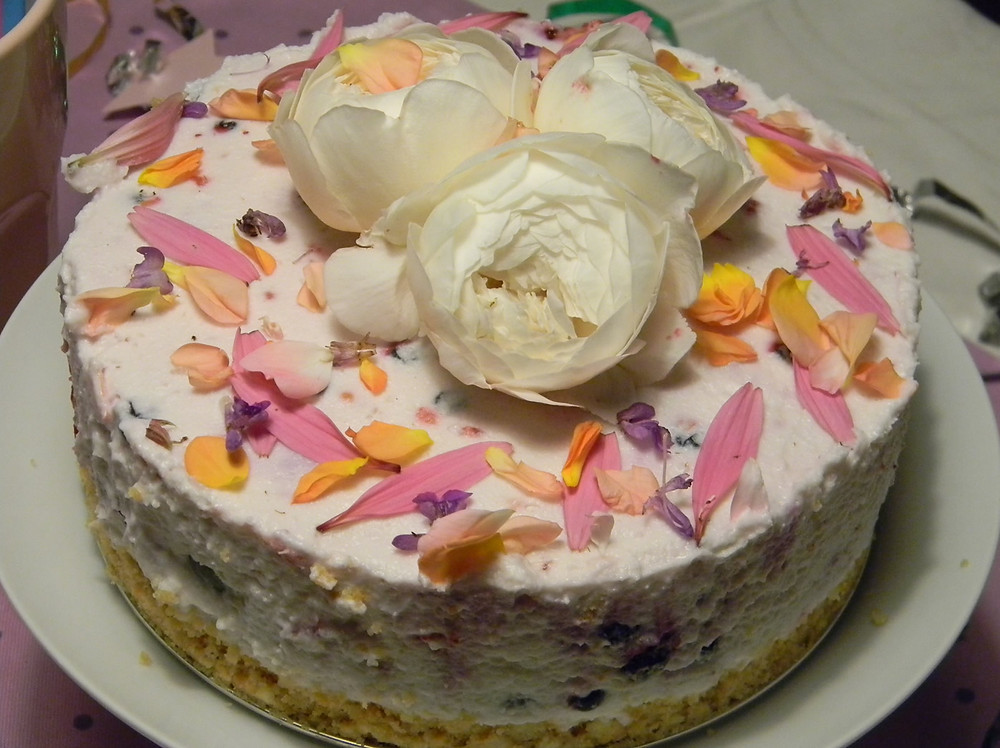 Cheesecake with edible herb flowers