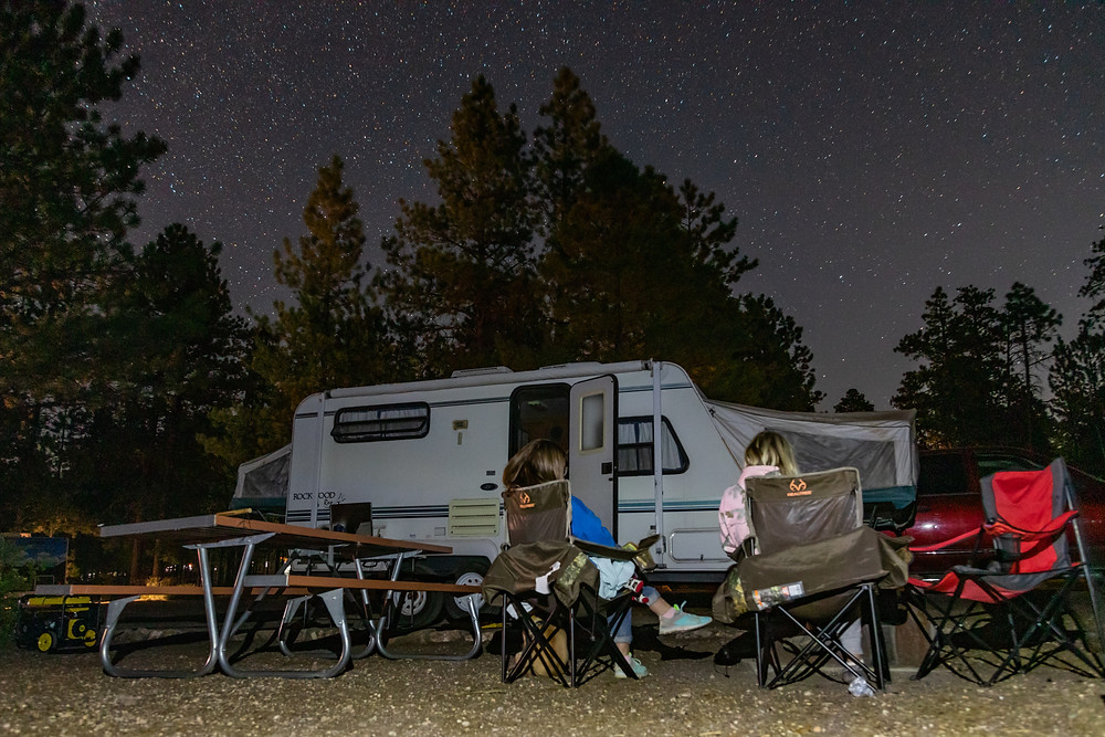 Camping in a trailer under a starry sky in Bryce Canyon.