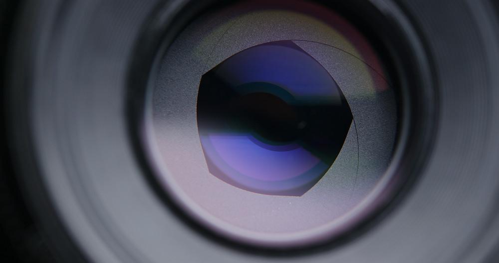 Aperture blades inside a lens set to a wide aperture.