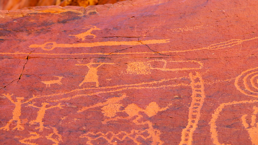Petroglyphs at Atlatl rock featuring ancient symbols.