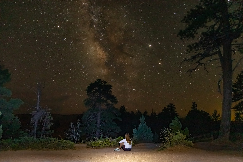 An astro photography portrait under a starry sky and the Milky Way Galaxy
