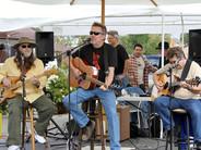 Chris performs at the Petaluma Palooza concert in Petaluma, California, in September 2013. He is accompanied by Preston Bailey (bass) and Gary Grubb (lead guitar).