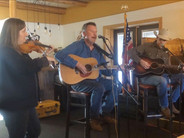 """Chris Samson performs """"The L&N Don't Stop Here Anymore,"""" accompanied by Elsabe Kloppers and Andy Hedges at the Pagosa Springs Brewery in Pagosa Springs, Colorado, in September 2018."""