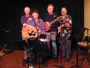 """""""Songwriters at Work."""" Scott O'Brien, Larry Potts, Chris Samson and Steve Della Maggiora perform at Ruth McGowan's Brewpub in Cloverdale, Calif. in April 2014."""