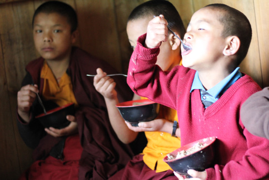 Little kids enjoying their meals