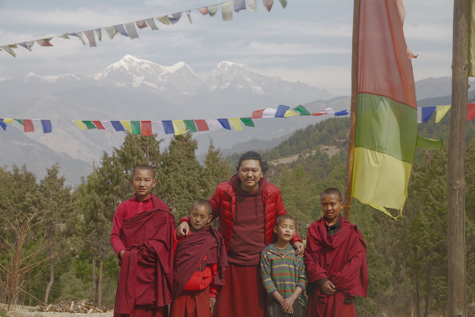 Rinpoche with little monks