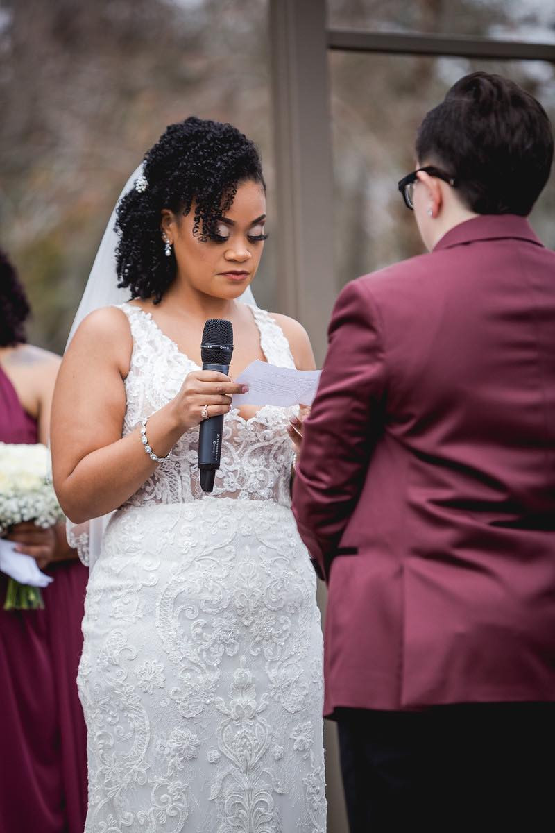 bride reading her written vows