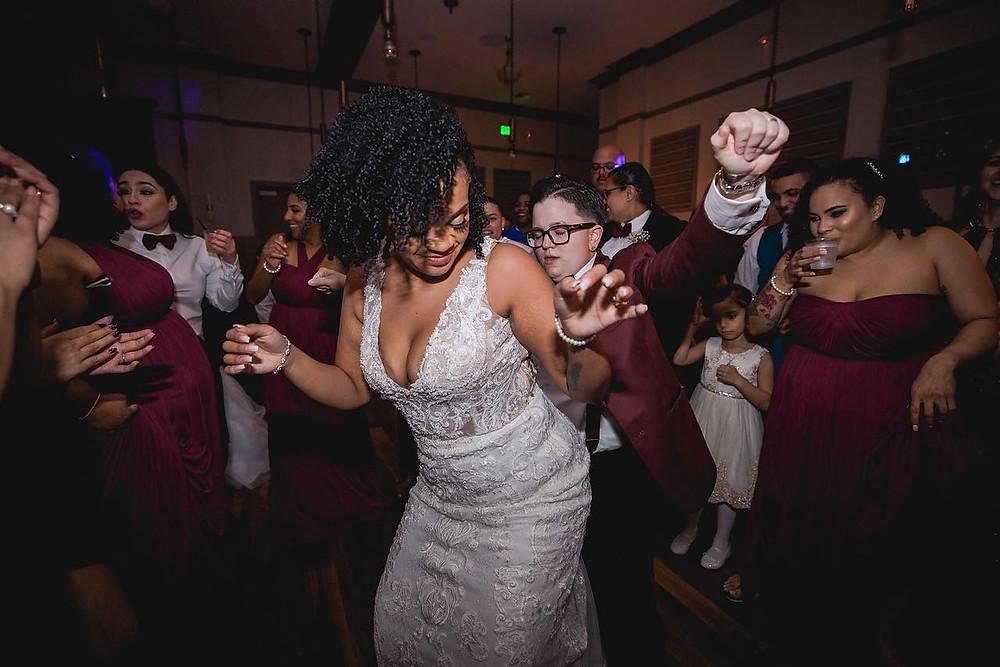 brides dancing together on the dance floor
