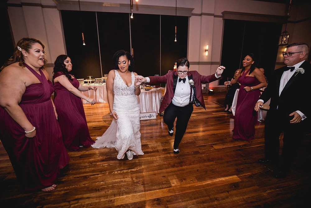 wedding couple dancing down soul train line