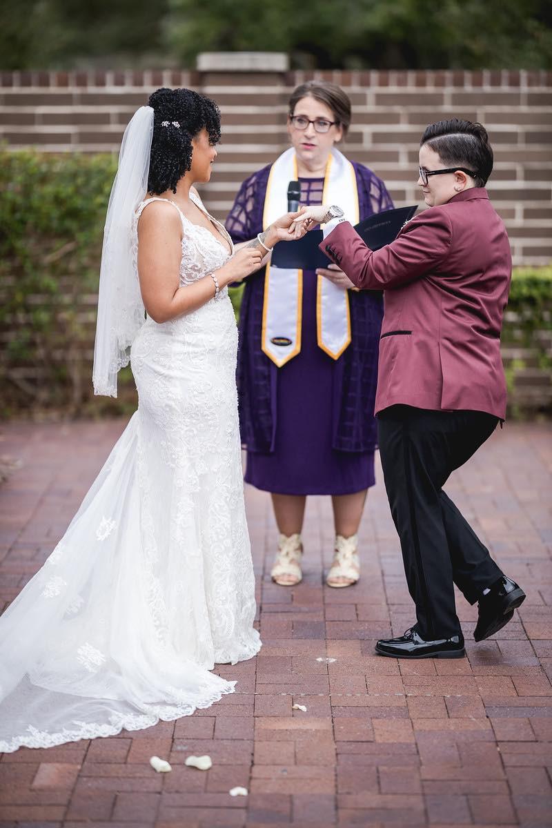 wedding couple exchanging rings