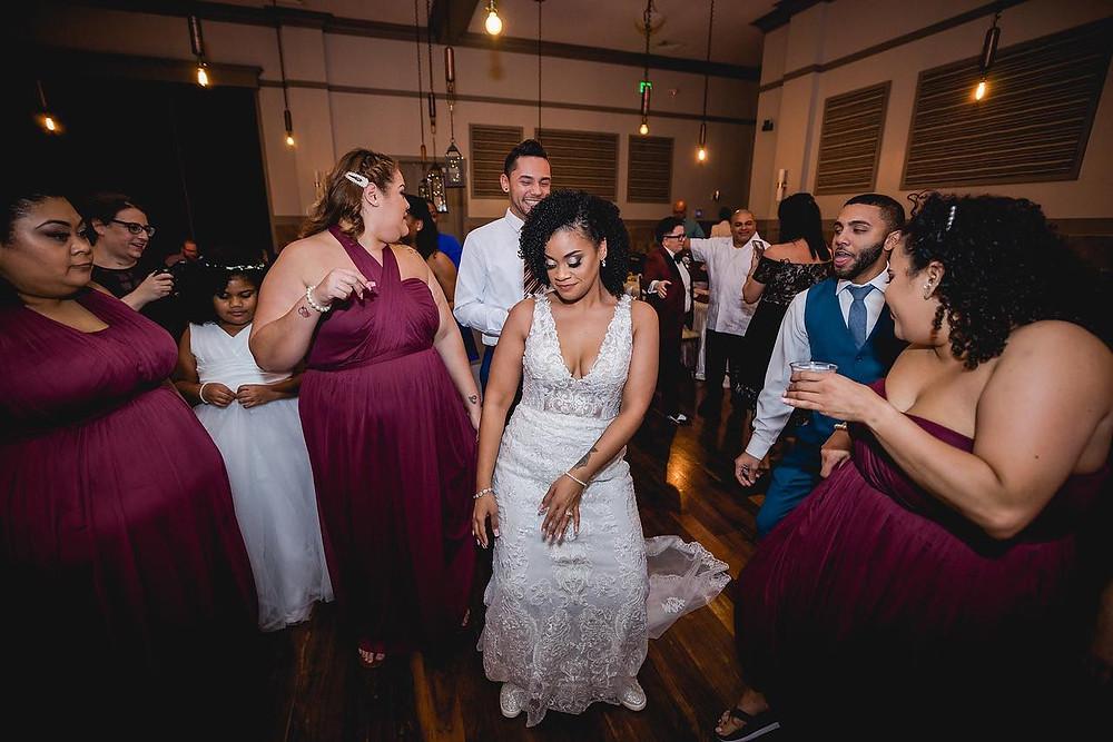Bride dancing with bridal party