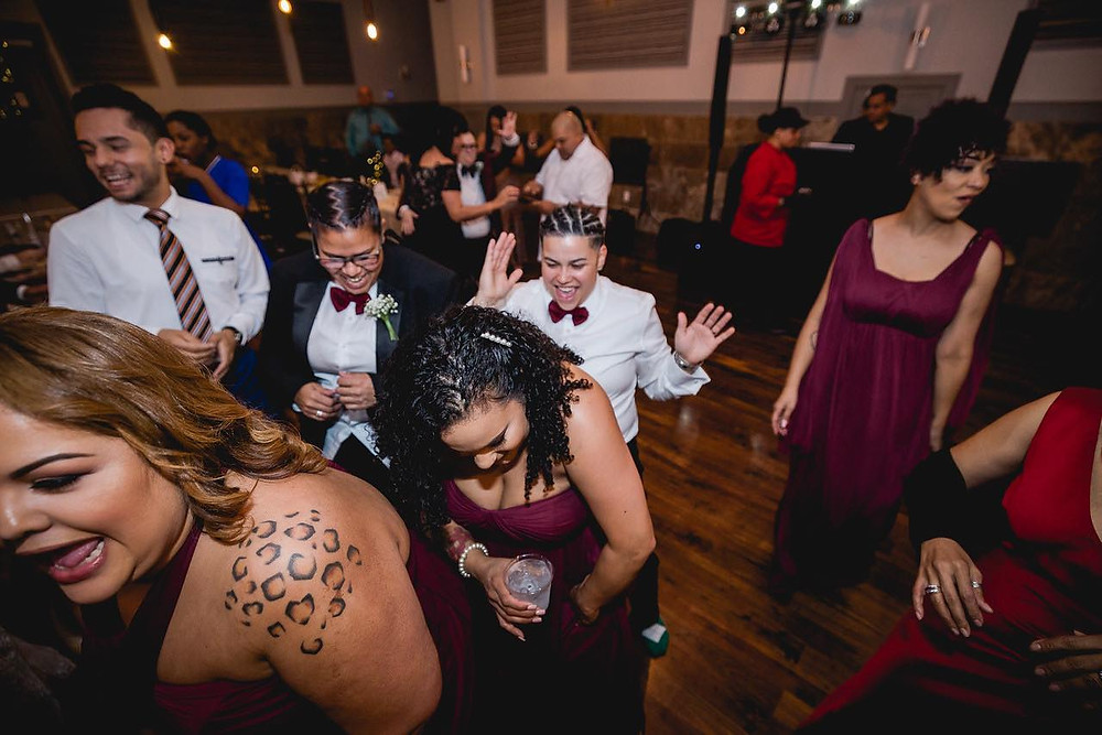 bridal party having fun on the dance floor