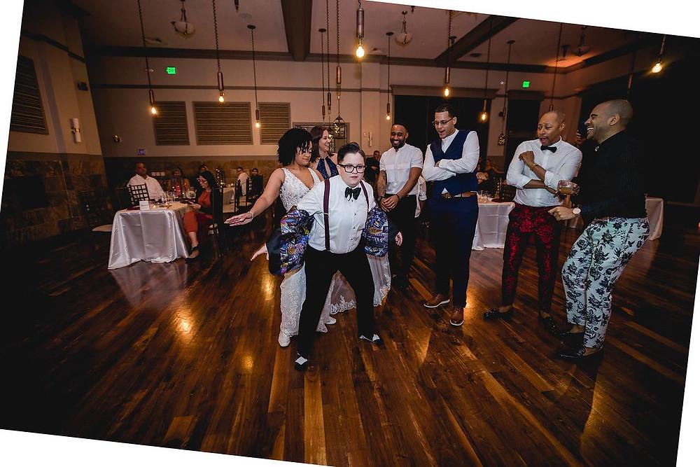 wedding couple front and center on dancefloor