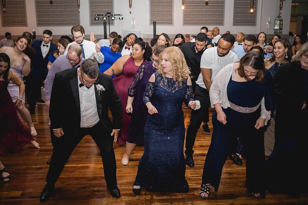 wedding guests dancing in a group