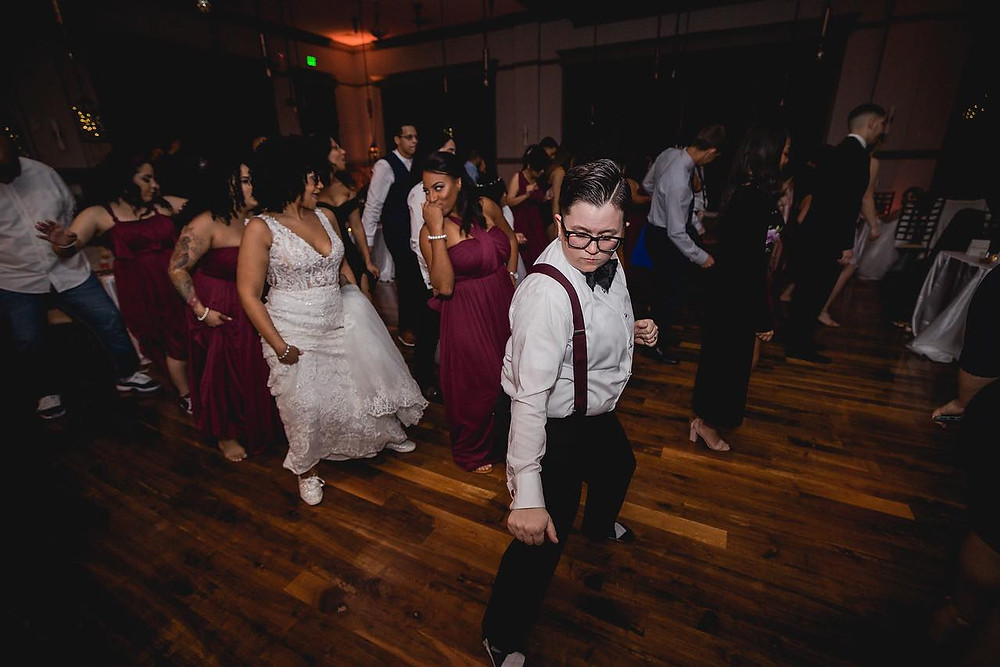 Wedding guests dancing with couple