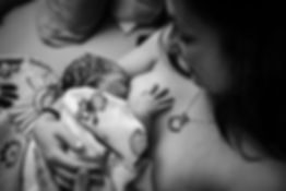 Newborn breastfeeding skin to skin at homebirth